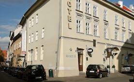 White plastered exterior of two storey hotel on corner of road Hotel Amadeus Krakow
