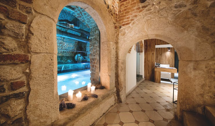Hotel Copernicus Krakow indoor pool spa stone room with archways candles