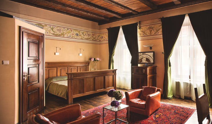 Hotel Copernicus Krakow luxury double bedroom wooden ceiling  leather chairs two large windows