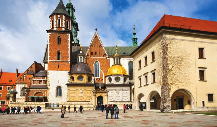 Turrets and towers of medieval buildings and cathedral in Krakow