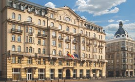 Polonia Palace Hotel exterior from the front with a large building and lots of small arched windows
