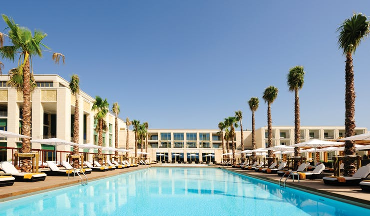 Anantara Vilamoura Portugal outdoor pool with sun loungers and umbrellas