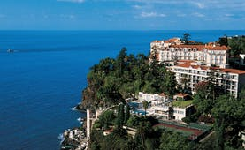 Belmond Reid's Palace Portugal exterior white hotel building pools tennis court sea view