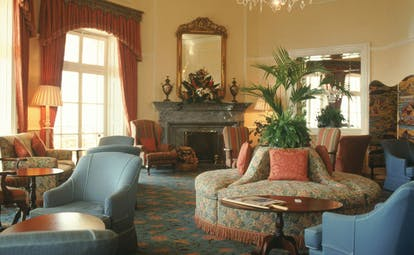 Belmond Reid's Palace Portugal guest lounge traditional decor armchairs fireplace chandelier