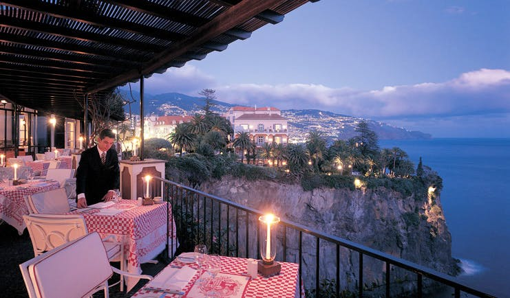 Belmond Reid's Palace Portugal terrace dining rustic table cloths cliff top sea view