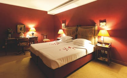Executive room with red colour scheme, red walls and bed