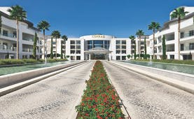 Conrad Algarve entrance, pathways leading to hotel door, fountains on each side