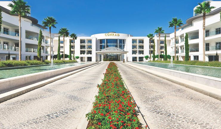 Conrad Algarve entrance, pathways leading to hotel door, fountains on each side
