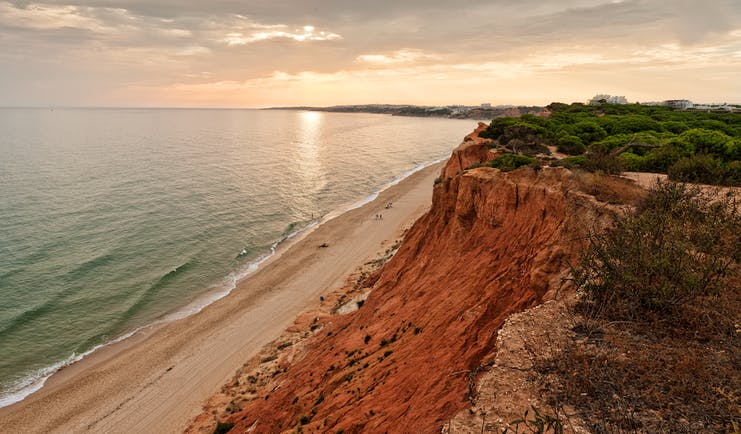Epic Sana beach, cliffside, sandy beach with blue ocean water