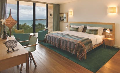 View of the beach room at the Martinhal Beach Resort and Hotel including a large double bed, big windows looking over the sea