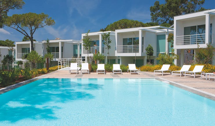 Martinhal Cascais Portugal exterior pool white buildings with balconies overlooking outdoor pool with loungers