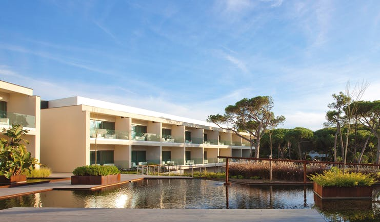 Martinhal Cascais Portugal hotel exterior white buildings with balconies overlooking ponds