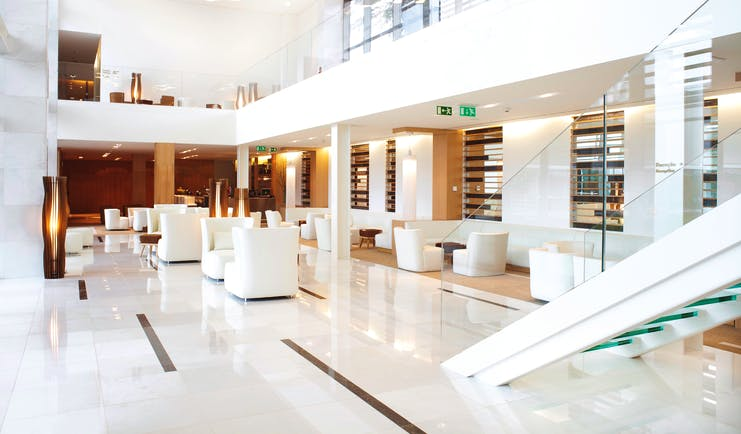Martinhal Cascais Portugal lobby area with white marble floors and armchairs