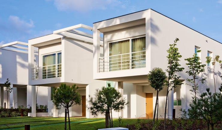 Martinhal Cascais Portugal luxury villa exterior large white buildings white balconies