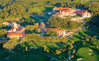 Penha Longa Portugal aerial view of golf course surrounded by trees and complex of buildings