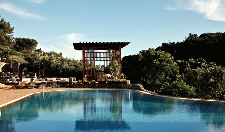 Penha Longa Portugal outdoor infinity pool with pagoda next to seating area