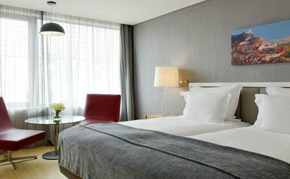 Pestana Cidadela Cascais classic room, double bed, modern chairs, artwork on wall