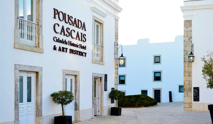 Pestana Cidadela Cascais entrance, hotel buildings, shrubs in potd