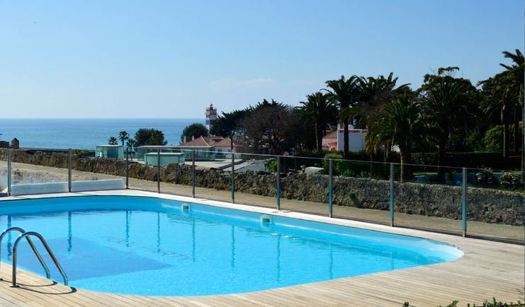 Pestana Cidadela Cascais outdoor pool, terrace, sea in background