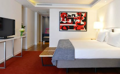 Pestana Cidadela Cascais presidential suite, double bed, television, modern art on walls