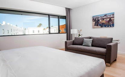 Pestana Cidadela Cascais superior room, double bed, sofa, light bright decor
