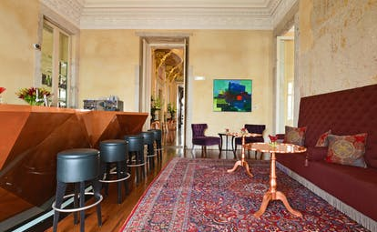 Pestana Palacio do Freixo Bar Nasoni, leather bar stools, wooden bar, antique rug, intricate architecture