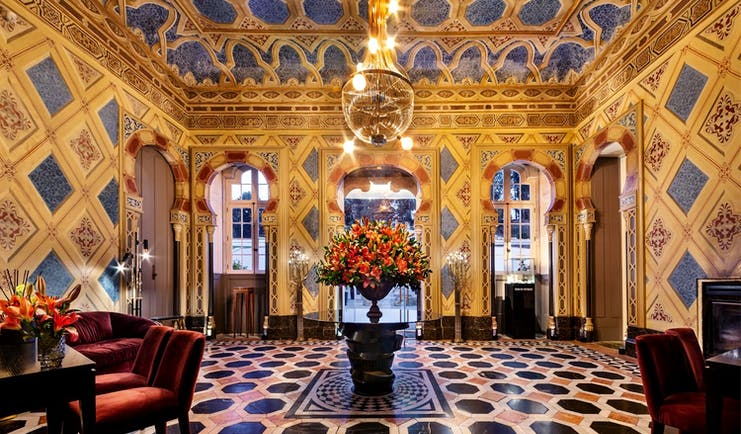 Pestana Palacio do Freixo entrance hall, intricate colourful tiling on walls and floors