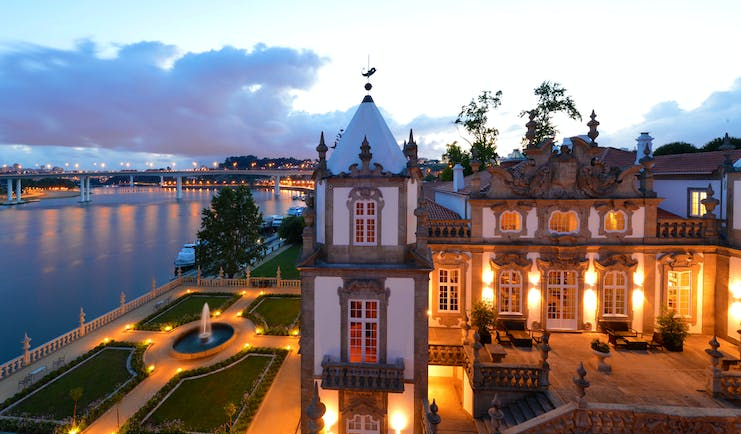 Pestana Palacio do Freixo grounds, hotel building and courtyard at twilight, hotel gardens overlooking river