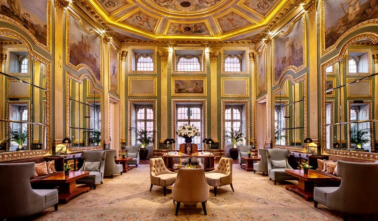 Pestana Palacio do Freixo lobby, ornate painted ceilings and frescoes and gold gilting, leather armchairs