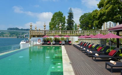 Pestana Palacio do Freixo pool, overlooking river, sun loungers with parasoles