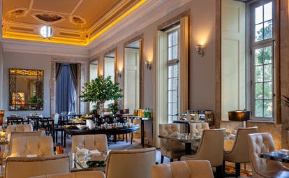 Pestana Palacio do Freixo restaurant, tables and chairs, high ceilings, sash windows