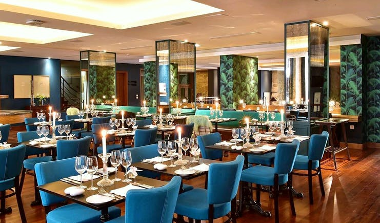 Pestana Vintage Porto restaurant, tables and chairs, wooden floors, blue details