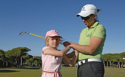 Pine Cliffs Portugal golf academy woman teaching young girl how to play golf