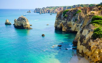Lagos shoreline in the Algarve, cliffs, rock formations, bright blue sea