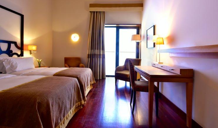 Pousada Convento de Tavira classic room, double bed, modern decor, door leading to terrace