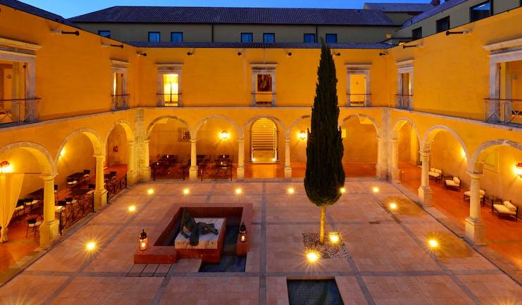 Pousada Convento de Tavira courtyard at sunset, colonnaded cloisters