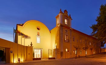 Pousada Convento de Tavira exterior at night, historic hotel building