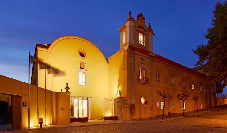 Pousada Convento de Tavira exterior at night, historic hotel building