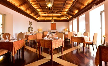 Pousada Convento de Tavira restaurant, tables and chairs, wood panelled ceiling