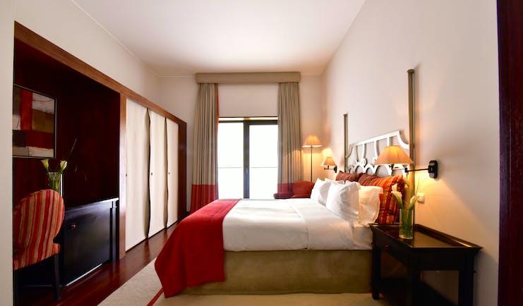 Pousada Convento de Tavira superior room, bed, modern decor, door leading to terrace