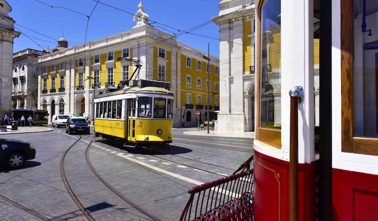 Pousada de Lisboa exterior, yellow hotel builing, yellow tram, streets of Lisbon
