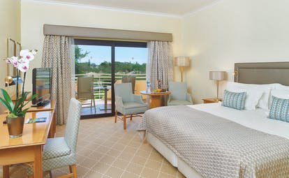 Quinta do Lago Portugal bedroom with desk and patio doors to balcony with sun loungers