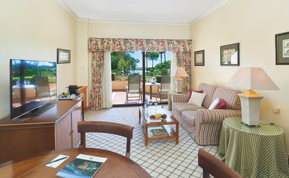 Quinta do Lago Portugal garden suite lounge with patio doors to terrace