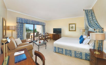 Quinta do Lago Portugal premium golf bedroom with sitting area and desk and patio doors to balcony