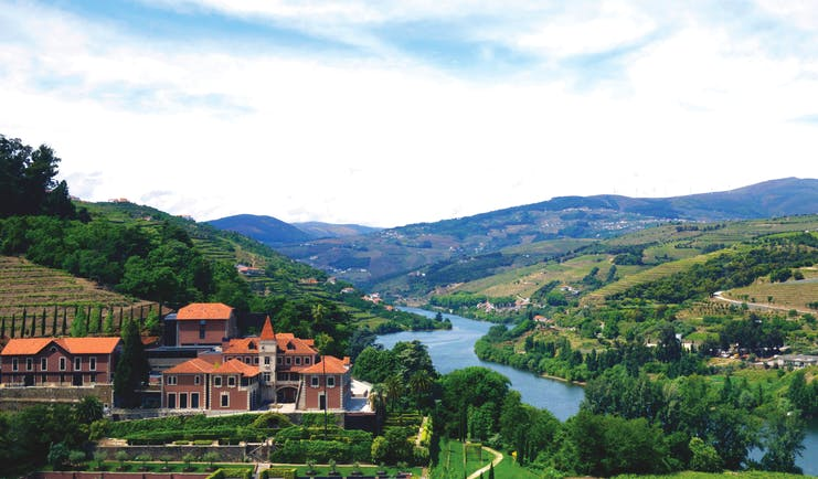 Six Senses Douro Valley Portugal aerial panorama of complex of buildings in a valley next to a river