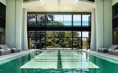 Six Senses Douro Valley Portugal indoor pool with floor to ceiling windows and loungers