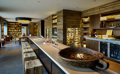 Six Senses Douro Valley Portugal wine library bar area with wine fridges and wooden stools