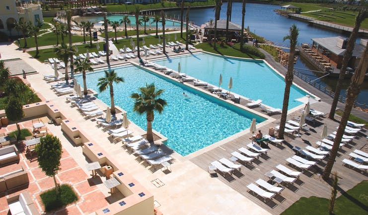 The Lake Spa aerial shot of pools, sun loungers, umbrellas, palm trees