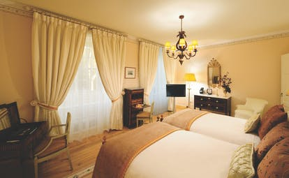 Tivoli Palacio de Seteais Portugal deluxe bedroom with two large beds and large windows with drapes