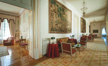 Tivoli Palacio de Seteais Portugal lobby large hallway with tapestry sofas and coffee tables